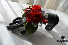 Red spray rose wristlets with silver ribbon for mothers and grandmothers for a red rose wedding! Flowers and Photograph by Rosie's Floral Boutique #corsage #red #roses #wedding #mob #mog #grandmothers