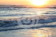 Sunset in the sea waves