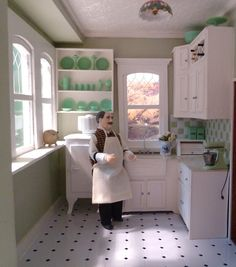 White kitchen with jadeite.  This is a doll house.  Cute!  and so detailed!  I didn't catch on it was a doll house at first and I wondered why the owner had a large statue of a man in the kitchen.