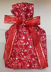 Make a bunch of these, all season fabric gift bags.  All sizes!  Then sew on a small label on the bottom with your name, city, year and it will go from one house to another for years to come!  Easy to make and recipients love them!    Stop the paper waste :)