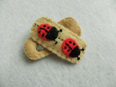 These obscenely cute hairclips feature a red and black ladybirds on a beige felt background. They are securely stitched around bendy metal snap hair grips so they stay put, and are suitable for children as well as adults. Personalised Gifts Handmade, Hair Grips, Hair Slide, Gifts For Kids, Craft Supplies, Cool Designs, Arts And Crafts, Stitch, Cute