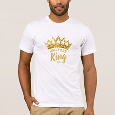 Let them know you're the Bag Toss King with this fun custom shirt featuring a gold glitter crown. Personalize it with your own phrase and date. Feel free to contact me if you need help or a custom order.