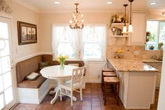 I love this sitting area int he kitchen. The bench also doubles as extra storage