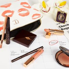We're packing up our CTilburymakeup beauty bag essentials to jet off to #MFW. To perfect your flawless fashion week look, shop Charlotte Tilbury now at NET-A-PORTER.COM #onsite #NETABeauty