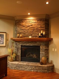 Find ideas and inspiration for Tiled Fireplaces to add to your own home. #fireplace #cornerfireplace #tilefireplace