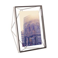 Display your cherished memories in chic style with this Prisma photo display from Umbra. With three dimensional geometric features, this frame has a shining chrome finish and has been designed by S...