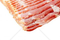 cropped image of sliced raw bacon. - Cropped image of sliced raw bacon isolated on white background.