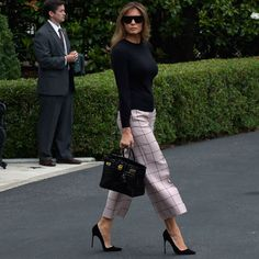 7/5/17 Melania wore Valentino pants as she departed WH for trip to Poland.