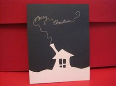 """This homemade Christmas card was easy to mass produce. I simply cut out the snowy house scene, glued it on thick blue paper, and wrote ""Merry Christmas"" coming out of the chimney with a silver pen."""