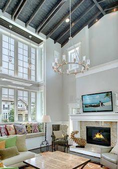 high ceilings, chandelier, large windows, mounted flat screen