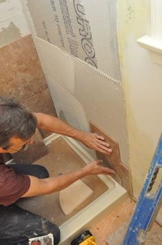 Great step by step pictures on how to tile a shower!