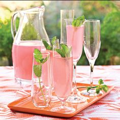 Sparkling pink punch 1 (12-oz.) can frozen pink lemonade concentrate, thawed 4 cups white cranberry juice cocktail 1 qt. club soda, chilled Garnish: fresh mint sprigs Substitute 1 bottle of dry Champagne and 1/4 cup orange liqueur for club soda for a Champagne punch. -Southern Living wedding shower