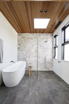 Wondering what bathroom and tile trends will be big this year? From bold terrazzo finishes to large format concrete tiles, Christie Wood, Beaumont Tiles Design Specialist, shares the colours, sizes and tile design styles that you can expect to see in many Grey Bathrooms, White Bathroom, Beautiful Bathrooms, Small Bathroom, Master Bathroom, Wood In Bathroom, Grey Floor Tiles Bathroom, Bathroom Feature Wall Tile, Jacuzzi Bathroom