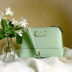 Kate Spade Wellesley Hanna Crossbody NWT Kate Spade Wellesley Hanna Crossbody  Color: mint mojito Gold tone hardware  Adjustable strap drop approx. 18 to 24 inches.  9 inches (L) x 6 inches (H) x 3 inches (W) Comes with Kate spade shopping bag  Beautiful mint green Crossbody shoulder bag! Perfect for spring and summer!! kate spade Bags Crossbody Bags