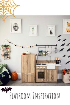 Playroom Inspiration | Play Kitchens | Hanging pot rack | Woodland Themed Playroom and Bedroom | Kids Room | Affordable Play Kitchens | Halloween Decor for Kids spaces | Fall Decor | Seasonal Playroom Decor | #Kidspiration #Playroom #Halloween #KidsKitchen