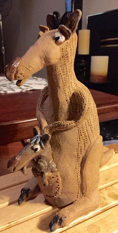 Stoneware kangaroo and joey.