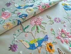 Check out this item in my Etsy shop https://www.etsy.com/uk/listing/534348553/hand-embroidered-bird-in-florals-vintage
