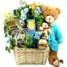 "Beary Special Get Well Wishes, w/Bounce Back Jack! - This get well basket is beary special indeed! This big and beautiful arrangement features the most adorable, handcrafted bear, ""Bounce Back Jack"", and a host of delicious comfort foods, all tucked into a bouquet of beautiful lifelike silk flowers! It's absolutely gorgeous!!"