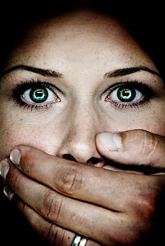 In many cases of Domestic Violence the women is scared of talking for many reasons including threats from her husband. Thats what this photo represents with the mans hand covering the women's mouth. End sexual assault forever at http://www.fuzeus.com