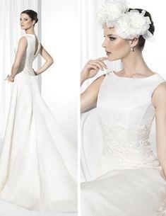 Traje de novia línea clásica confeccionado en Otomán Realce.