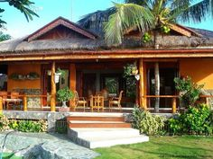 The bahay kubo is considered as an icon in the Philippines. See the evolution of the native house design made famous by Filipinos here. Modern Tropical House, Tropical Beach Houses, Tropical House Design, Simple Bungalow House Designs, Philippines House Design, Bahay Kubo Design Philippines, Bamboo House Design, Hut House, Philippine Houses