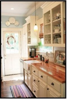 love this kitchen! (not the layout but the cabinets, hardware and color pallette)