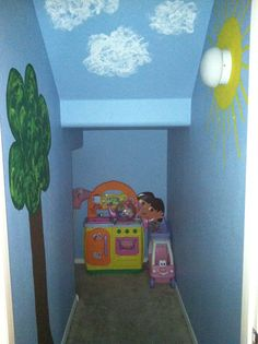 I painted our under the stairs closet and turned it into a play area