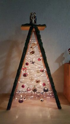 Another ladder tree thought. Another ladder tree thought. Ladder Christmas Tree, Cabin Christmas, Cowboy Christmas, Christmas Room, Rustic Christmas, Christmas Holidays, Christmas Crafts, Christmas Decorations, Xmas