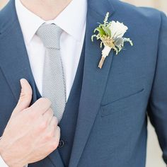 Navy wedding suit for the groom or groomsmen with a gray tie | The Modern Groom