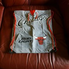 Bulls drawstring bag Never used, lightweight  perfect for your bulls fan!  Outside has pocket that appears more for fashion over function. Inside just has red lining and no pockets! Bags Backpacks
