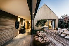 "Built on a lot formerly occupied by a home destroyed during the Christchurch earthquakes, the Andover Street House is a modern spin on the English farmhouse. The home is actually a series of four ""pavilions"" connected by flat-roofed glass galleries,..."