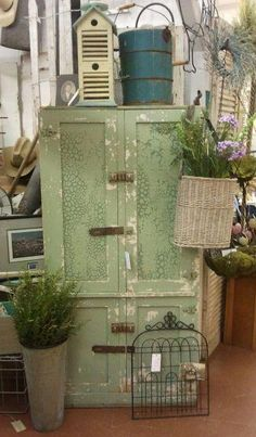 Great shabby chippy green cabinet-see it in the White Barn@The Feathered Nest Market,OKC :)