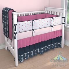 Girl Crib bedding in Solid Pink, Fuchsia Drops, Solid Navy, Navy Anchors, Fuchsia Puffs. Created using the Nursery Designer® by Carousel Designs where you mix and match from hundreds of fabrics to create your own unique baby bedding.