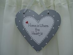 Handmade 'Home is where the heart is' wooden plaque on Etsy, £9.50