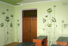 Green flowers hand painted on the walls of a classroom at a private school.