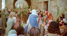 As Jesus walks through the crowds that greet him, they shout hosanna.