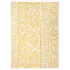 (PURCHASED.) Transform your den, dining room, or master suite into a bohemian retreat with this beautiful rug, showcasing an ikat-inspired motif in yellow.