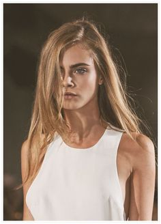 Cara Delevingne. Simple look with white sleeveless dress.