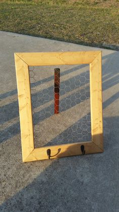 Wall hanging with chicken coop wire