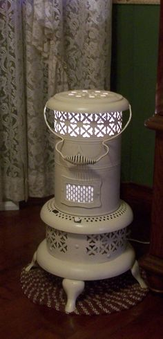 DIY Inspo: Kerosene heater, painted & converted to lamp. This is gorgeous!
