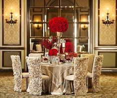 Champagne table cloth and red flowers <3