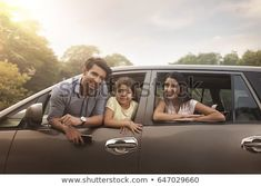Family looking out car window