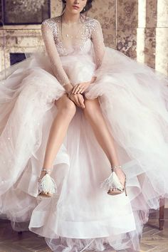 "Jimmy Choo recently unveiled new imagery of its bridal collection, highlighting its range of styles and featuring Monique Lhuillier's ""Aviva"" bridal gown from her Fall 2016 collection."