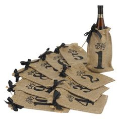 Burlap Bag Table Numbers at Target.  Fill these with little plants and use as centerpieces for a rustic event.