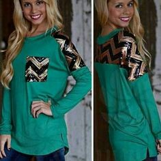 AVAILABLE NOW!  GREEN LONG SLEEVE WITH SEQUINS Long sleeves with black and gold sequins on the pocket and the shoulders. Wear with leggings or skinny jeans. Is a small XL fits a L Tops