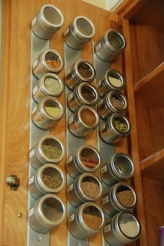 Never thought of putting these magnetic spice containers on the inside of the cabinet door.  Then chalkboard lids.  for larger quantites, put in glass jars and place on shelf.  PERFECTO!