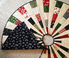Christmas tree skirt #1 by gngsears, via Flickr LOVE this idea --- like a memory quilt only for Christmas