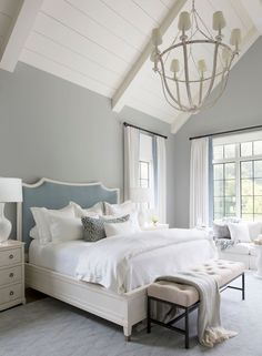 A velvet blue-gray headboard grounds the master bedroom, and sets the tone for its soft, dreamy vibe. Velvet trim was added to the off-white linen draperies and pillows.