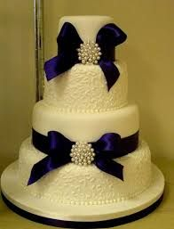 4 tier cake, 2 patterned layers and ribbon