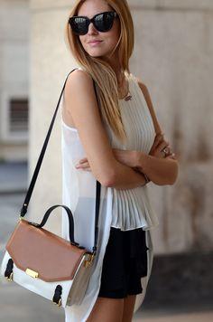 sheer white pleated tank blouse, black shorts